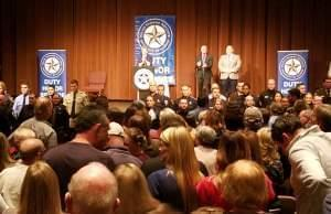 An dueince applauds the graduating class at the graduation ceremony for the University of Illinois Police Training Institute.