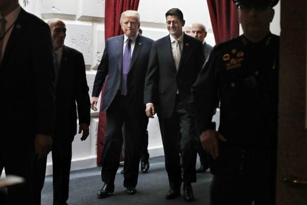 President Donald Trump, left, walks with House Speaker Paul Ryan of Wis., Thursday, Nov. 16, 2017, as they leave a meeting with House Republicans on Capitol Hill in Washington.