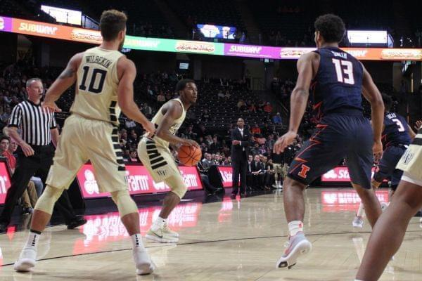 Wake Forest guard Bryant Crawford squares up for a three-pointer while Illini freshman Mark Smith defends in Illinois' 80-73 loss on Tuesday.