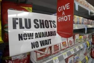 Sign promoting flu shots.