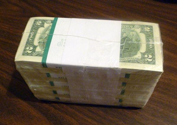 Stack of two dollar bills.