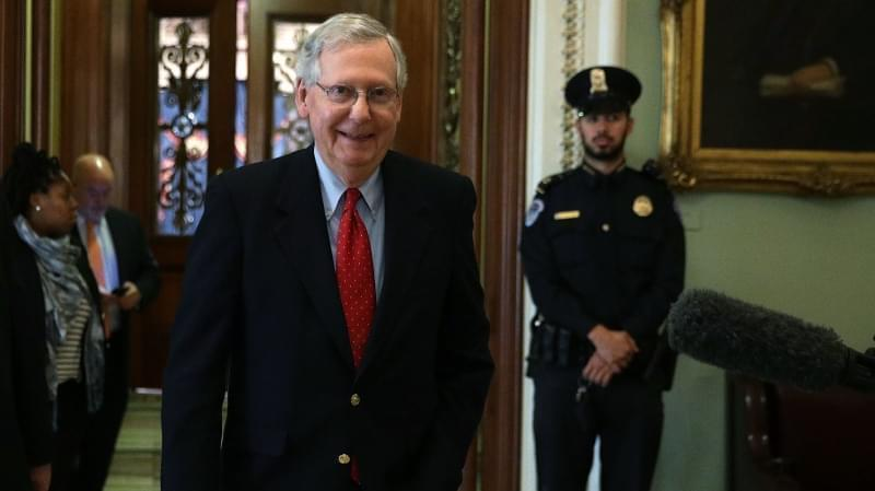 Senate Majority Leader Mitch McConnell said Friday that Republicans had the votes to pass a sweeping overhaul of the country's tax code. The measure passed early Saturday morning.
