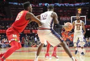 Illinois' Mark Alstork (24) passes to Leron Black (12) during a 92-91 overtime loss to Maryland Sunday night in Champaign.