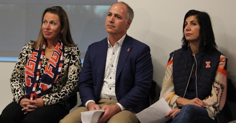 Anne Demirjian, Richard Demirjian, and Kara Demirjian-Huss listen as Josh Whitman announces the construction of Demirjian Park.