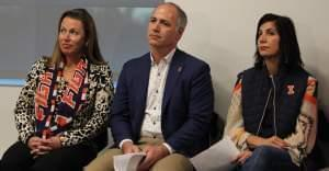 Anne Demirjian, Richard Demirjian, and Kara Demirjian-Huss listen as Josh Whitman announces the construction of Demirjian Park.