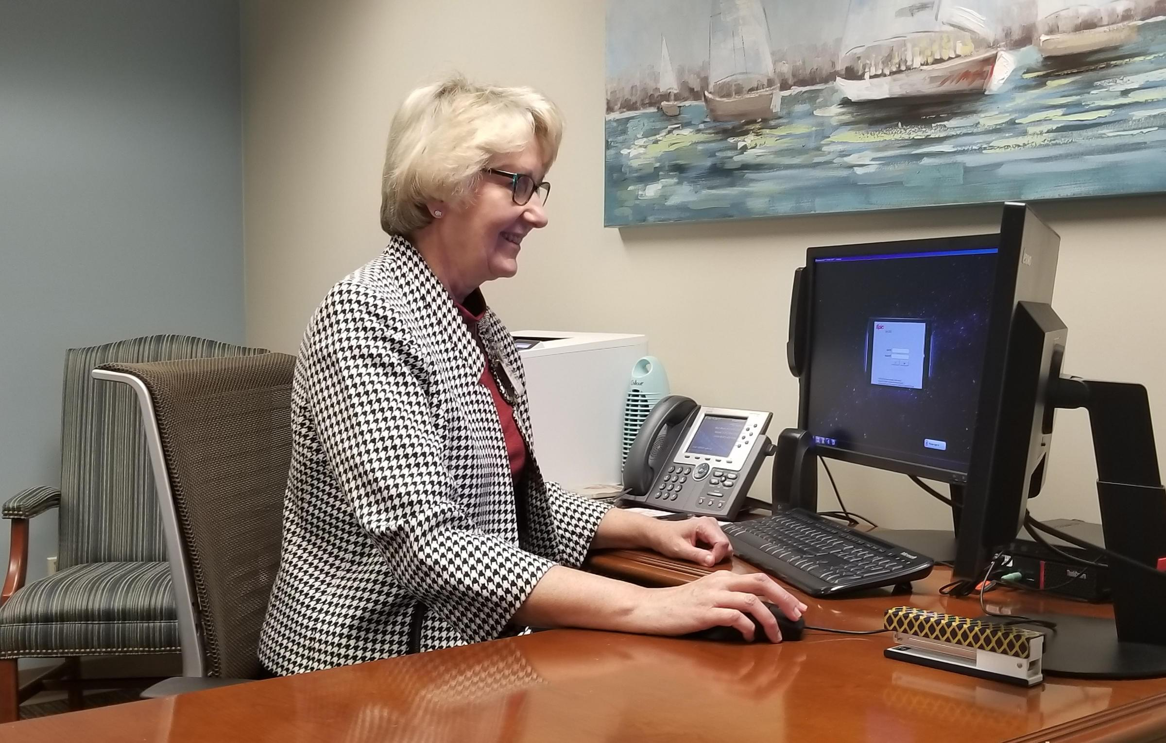 Dr. Gina Huhnke in her office at Midtown Deaconess Hospital in Evansville, Indiana.