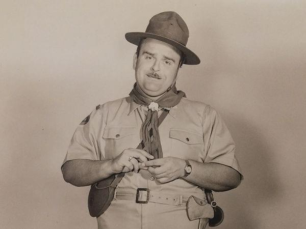 Trumpeter and Farmer City Native George Rock, wearing a Boy Scout uniform for a performance with Spike Jones And His City Slickers.