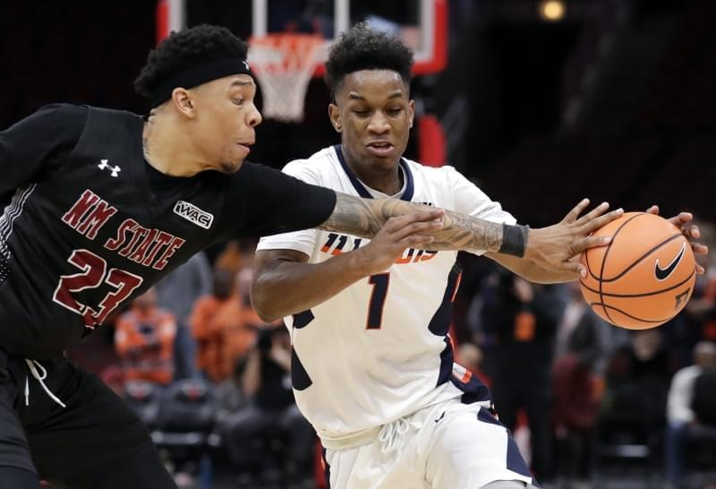 Illinois guard Trent Frazier, right, drives to the basket as New Mexico State guard Zach Lofton defends during the second half of an NCAA college basketball game Saturday, Dec. 16, 2017, in Chicago.