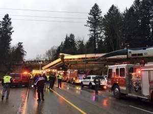 "An Amtrak train derailed south of Seattle and fell partly onto Interstate 5, where authorities initially reported ""injuries and casualties."""
