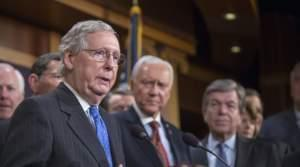 Senate Majority Leader Mitch McConnell (left) speaks at the press conference after the senate vote of the tax reform bill on Wednesday in Washington, D.C.