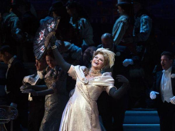 woman sings on stage as the met performs the merry widow