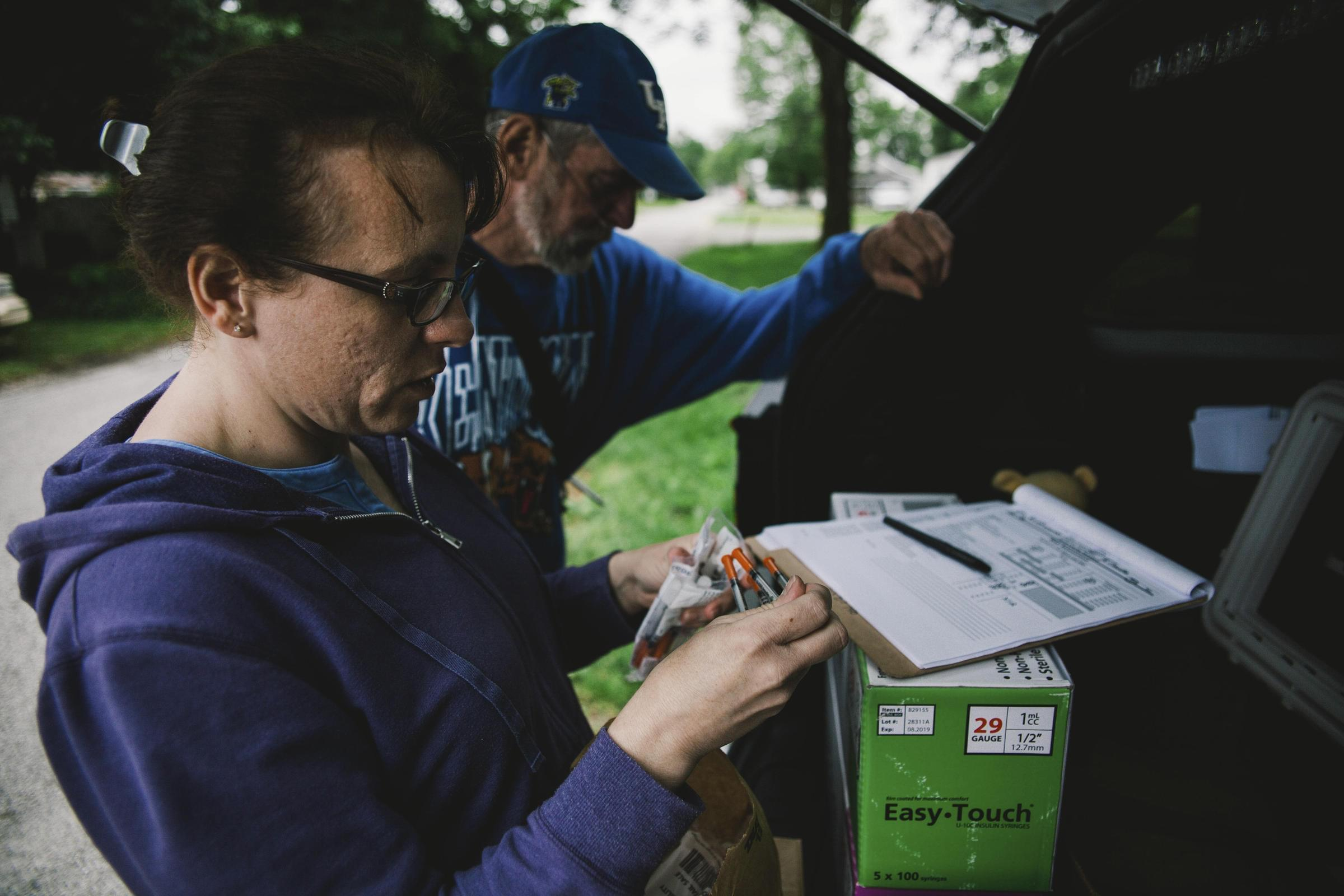 The Scott County Health Department's Brittany Combs makes a weekly stop with the county's syringe exchange program's mobile unit in Austin, Indiana.