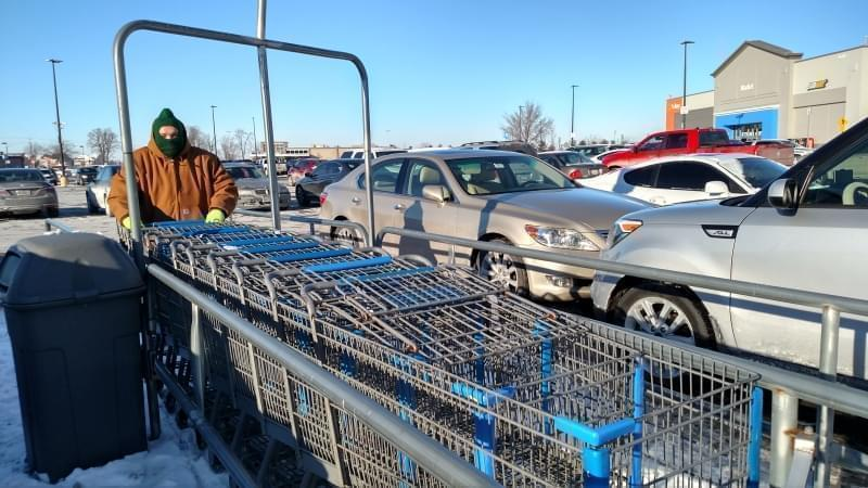 Seth Wills, 20, pushes a long row of carts at WalMart in Champaign on Tuesday, January 2, 2018.