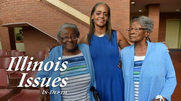 90-year-old twins Edna Mayes (left) and Ethel Sylvester, who are both residents of the East St. Louis Housing Authority, pose with East St. Louis Housing Authority Executive Director Mildred A. Motley at the Municipal Building in East St. Louis.