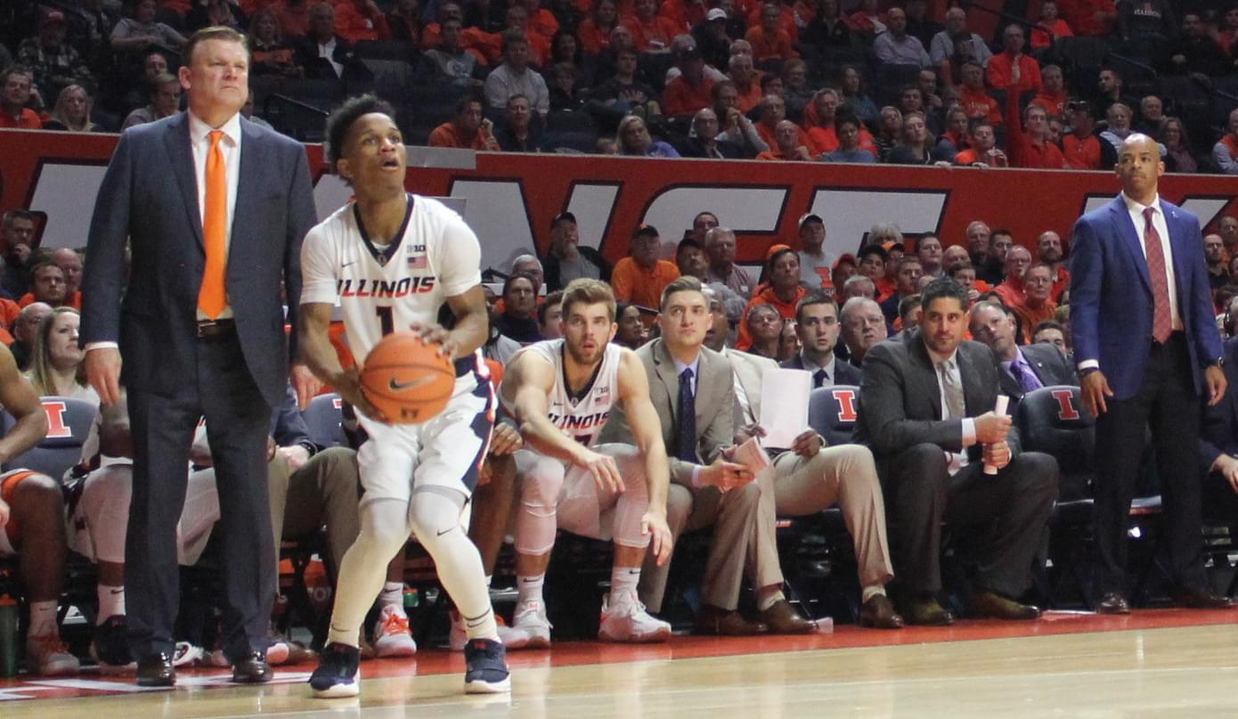 Trent Frazier shoots a three-pointer during a 104-97 overtime loss to Iowa.