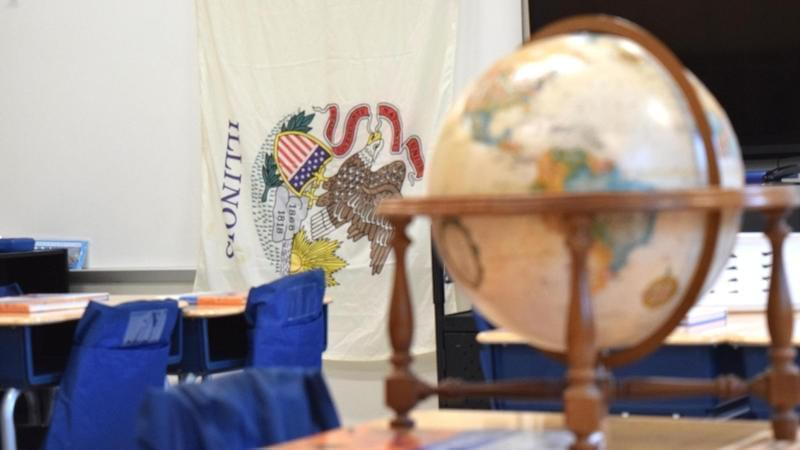Classroom featuring Illinois flag and world globe.