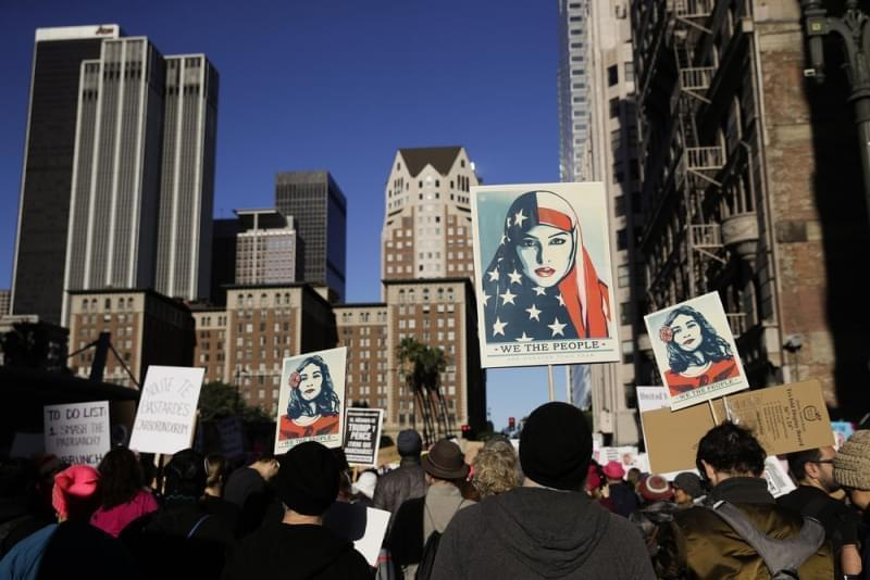 People gather for a Women's March, Saturday, Jan. 20, 2018, in Los Angeles.