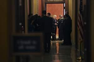 Senate Majority Leader Mitch McConnell of Ky., center, and Sen. Roy Blunt, R-Mo., at the end of a close-door meeting with fellow Republican senators, Monday, Jan. 22, 2018, on Capitol Hill in Washington on day three of the government shutdown.