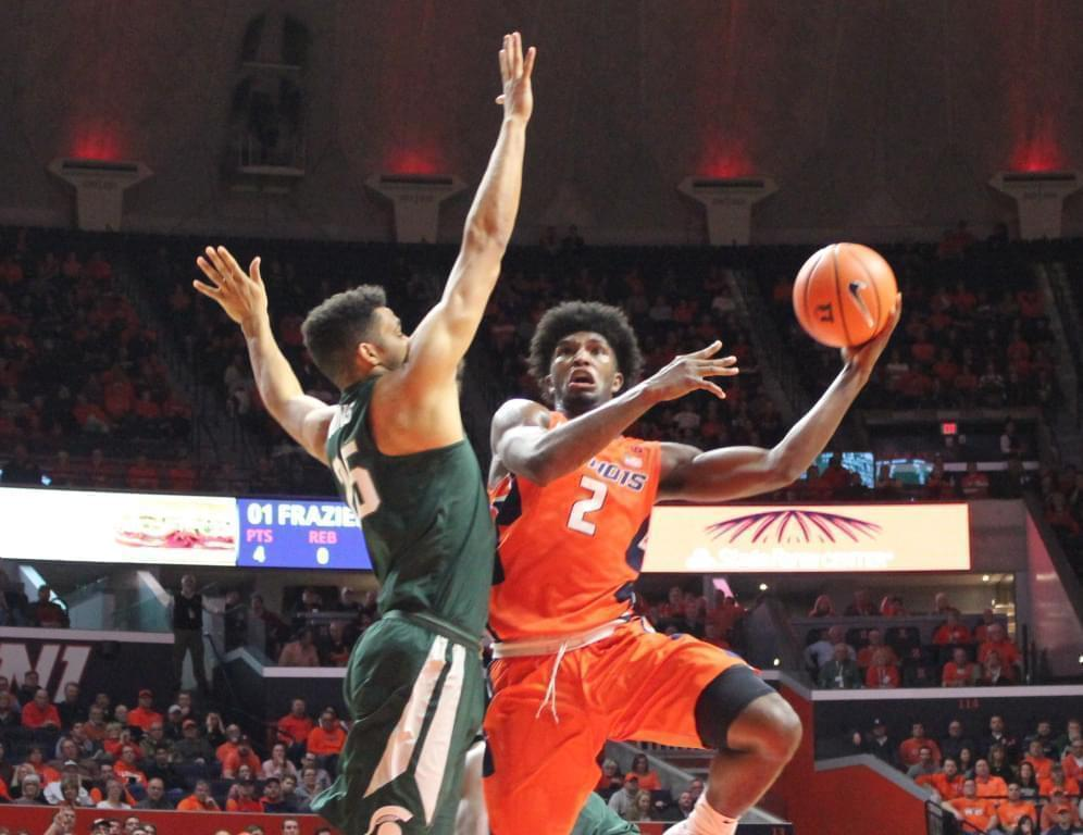 Illini Kipper Nichols (2) converts a left-handed hook shot despite the defensive pressure of Michigan State's Kenny Goins