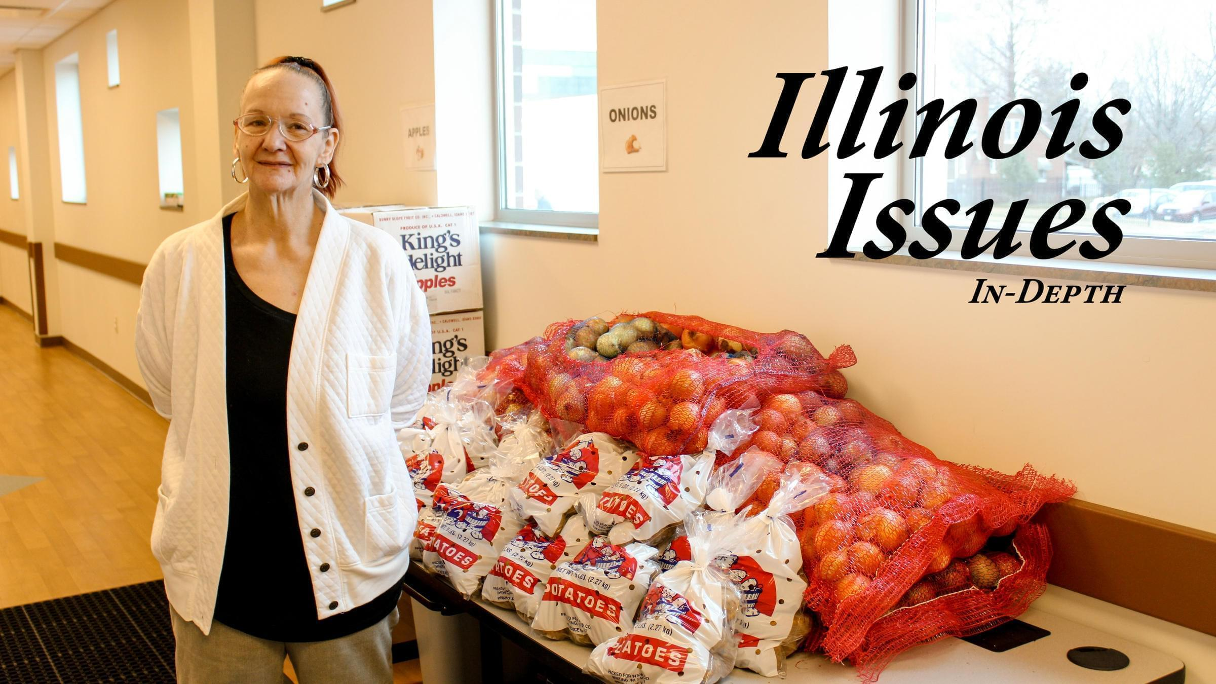 Susan Stolkes, a Springfield resident, stands in front of fresh produce being offered in January at the Central Counties Health Centers' food pantry.