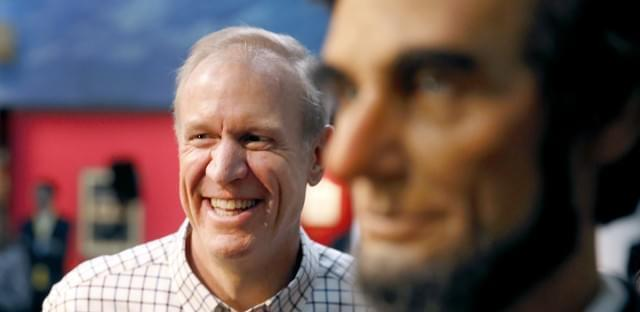 Gov. Bruce Rauner stands near a statue of Abraham Lincoln in Springfield on Jan. 11, 2015.