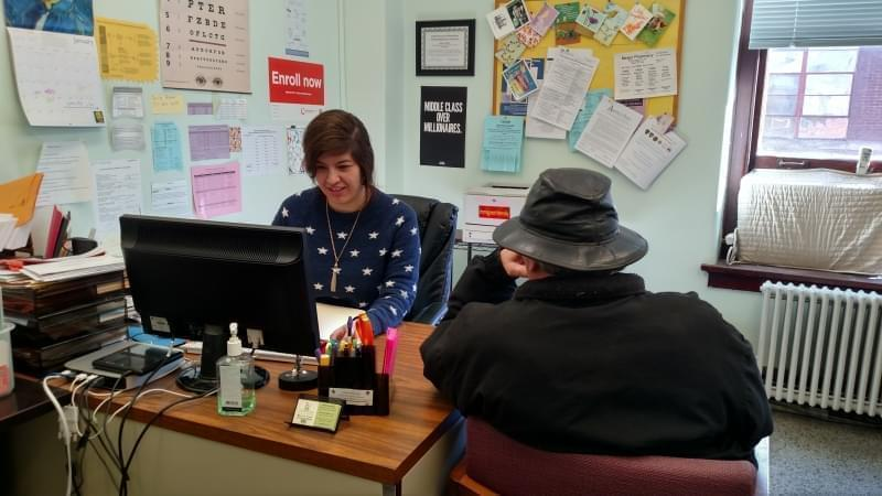 Adani Sanchez, client services coordinator for Champaign County Health Care Consumers, meets with a client in her office on January 2, 2018.