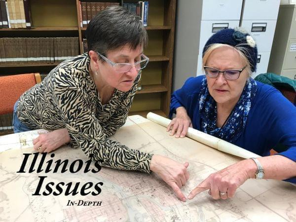 Katie Troccoli and Joan Bernabi review the map created by the department of energy at the Reddick Library.