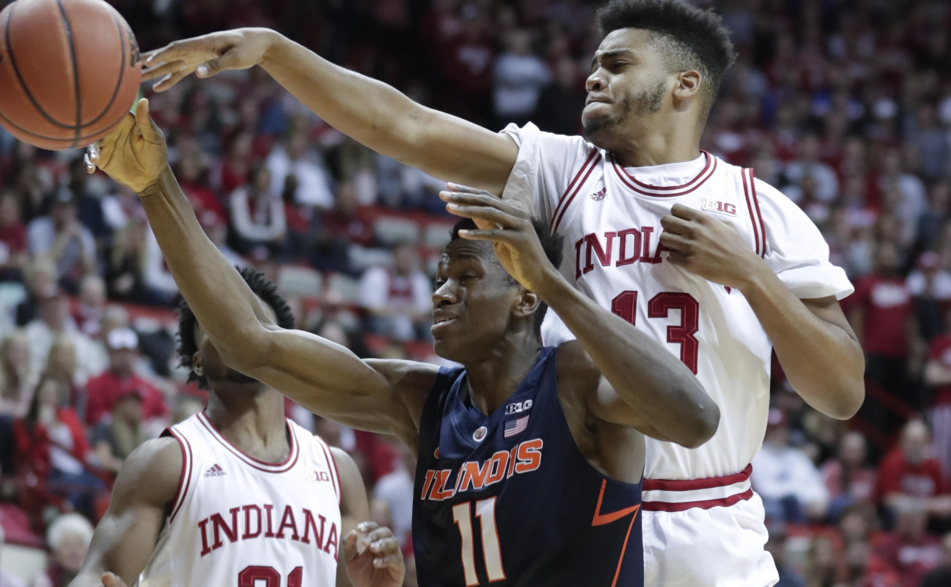 Indiana forward Juwan Morgan blocks the shot of Illinois forward Greg Eboigbodin.