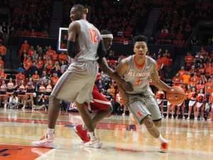 Leron Black (12) screens Nebraska's Glynn Watson to give Te'Jon Lucas (3) an opening toward the basket during a 72-66 Illinois win in Champaign.