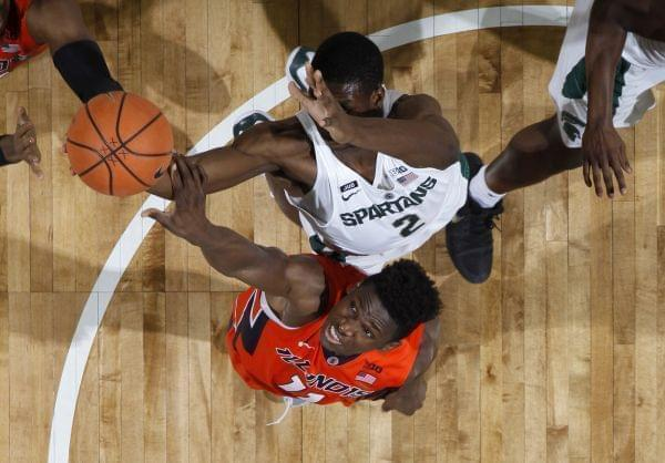 Michigan State's Jaren Jackson Jr., top, and Illinois' Greg Eboigbodin reach for a rebound during the second half of an NCAA college basketball game Tuesday, Feb. 20, 2018, in East Lansing, Mich. Michigan State won 81-61.