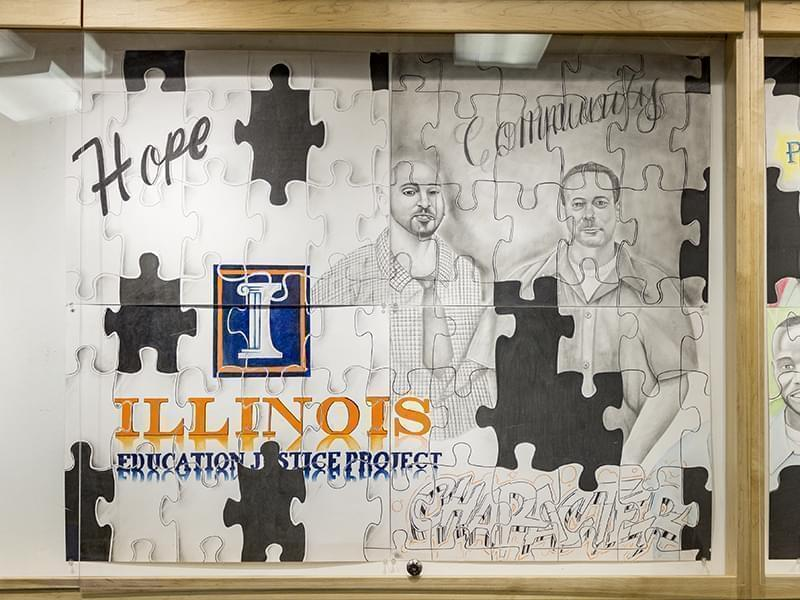 Five inmates at the Danville Correction Center created a mural composed of eight parts featuring the portraits of respected alums of the DCC college in prison program, the Education Justice Program. The artists behind the piece are also en