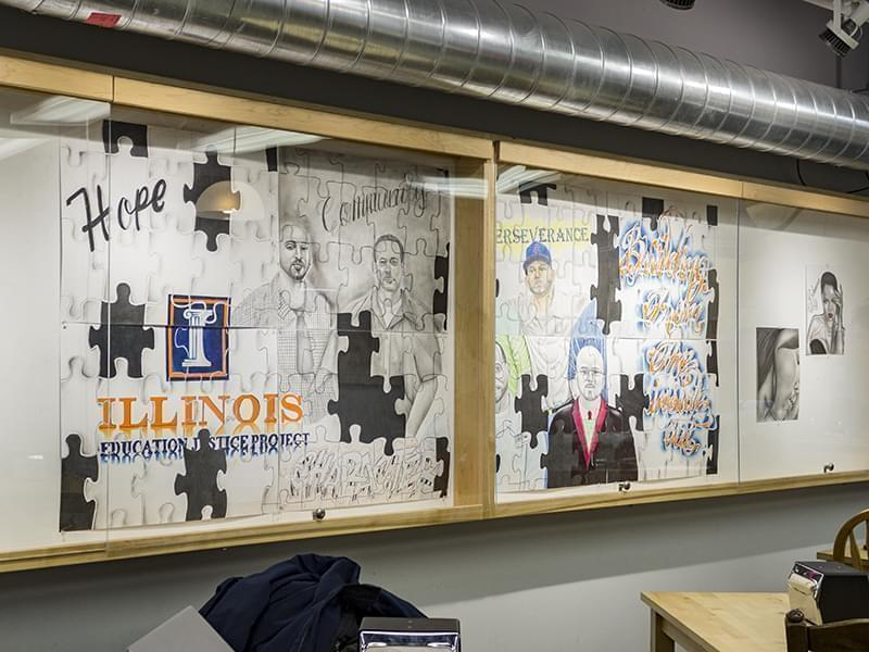 Five inmates at the Danville Correction Center created a mural composed of eight parts featuring the portraits of respected alums of the DCC's college in prison program, the Education Justice Program. The artists behind the piece are also enroll