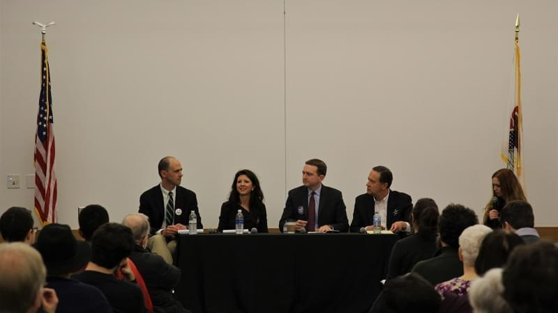 From left to right, candidates Jon Ebel, Betsy Dirksen Londigran, Erik Jones, and moderator Elizabeth Hess at a 13th Congressional District Democratic candidate forum on immigration on foreign policy.