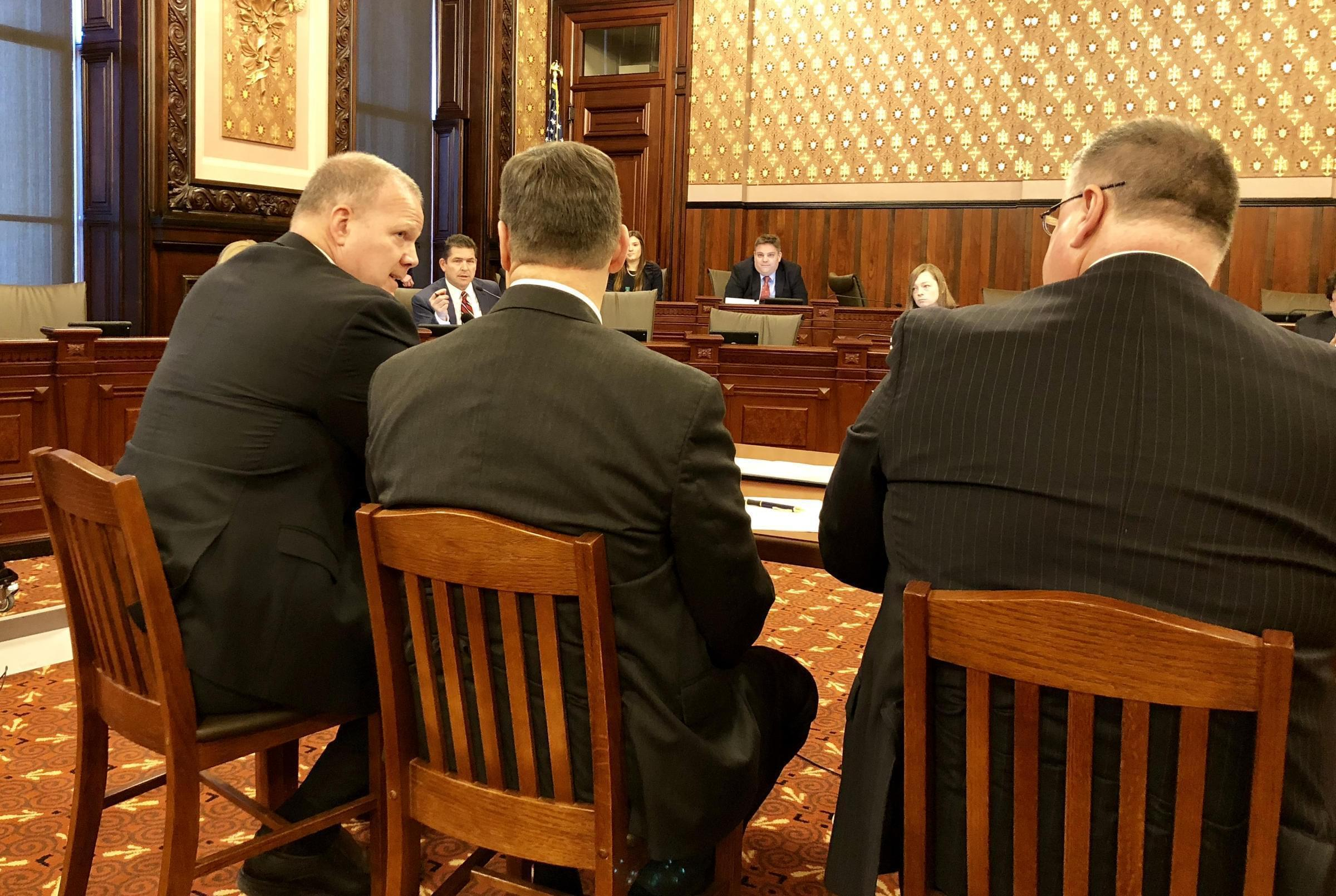 "State Sen. Kyle McCarter (in the red necktie) questions Illinois State Board of Education Superintendent Tony Smith (left) about his ""unrealistic"" budget request."
