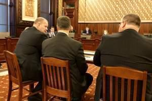"""State Sen. Kyle McCarter (in the red necktie) questions Illinois State Board of Education Superintendent Tony Smith (left) about his """"unrealistic"""" budget request."""