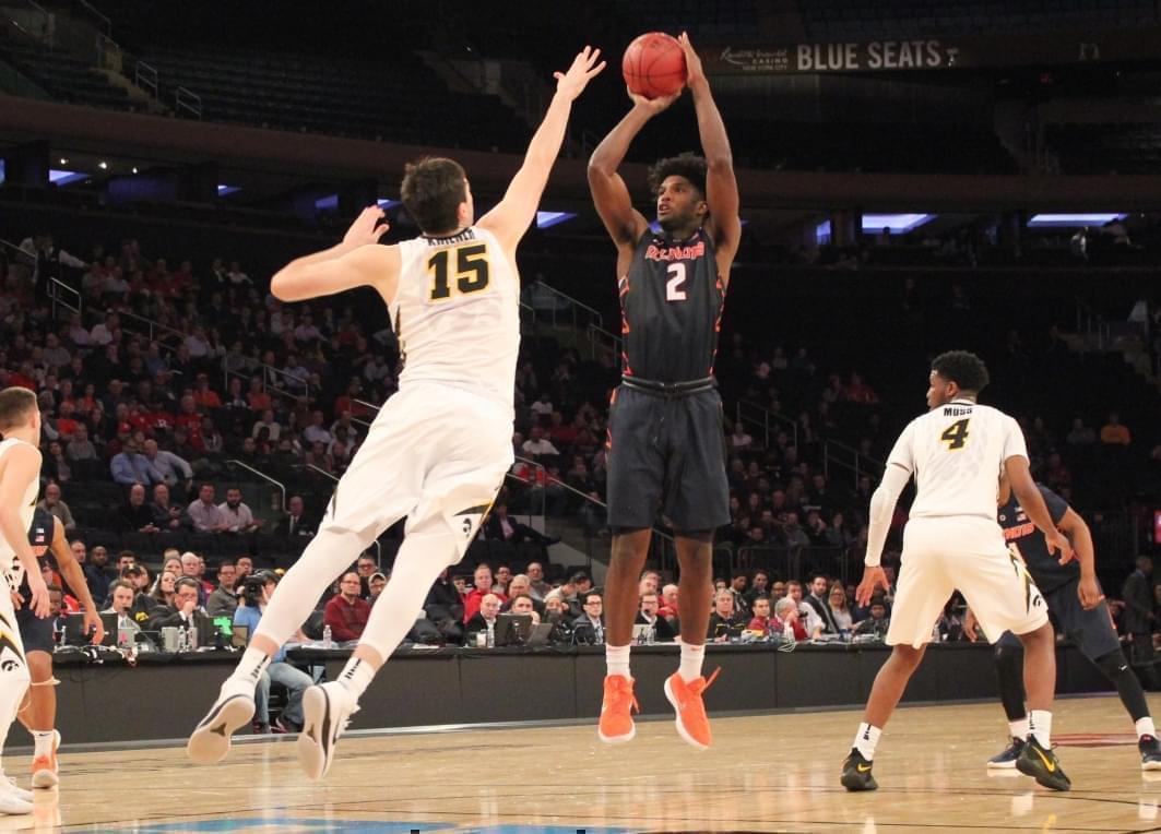 Kipper Nichols shoots over Iowa's Ryan Kriener, during the Illinois-Iowa game at the Big Ten Men's Basketball Tournament, Wednesday night in New York City