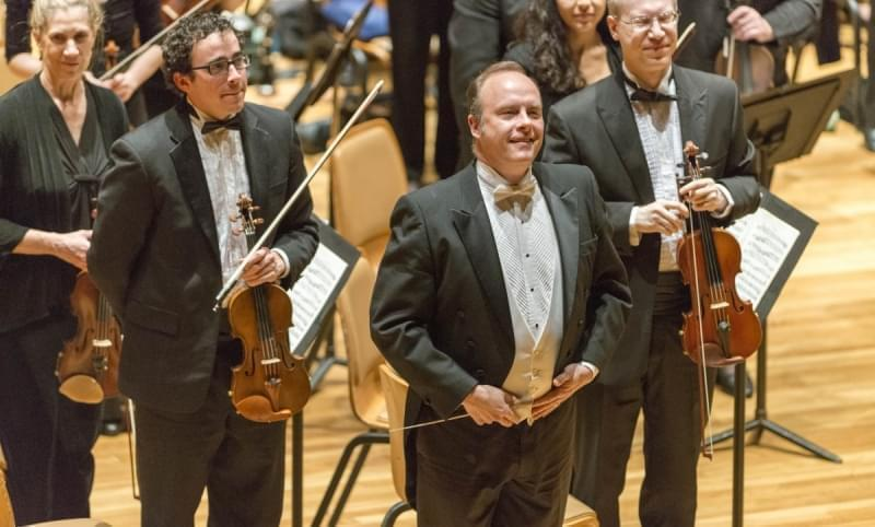 CUSO music director and conductor Stephen Alltop (second from right) on stage.
