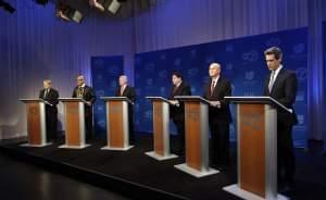 Democratic gubernatorial candidates Robert Marshall, Tio Hardiman, Chris Kennedy, J.B. Pritzker, Bob Daiber, and Illinois Sen. Daniel Biss, left to right, participate in a debate Friday, March 2, 2018, in Chicago.