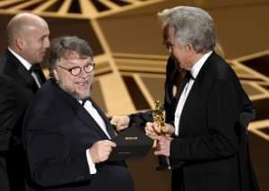"arren Beatty, presents Guillermo del Toro with the award for best picture for ""The Shape of Water"" at the Oscars."