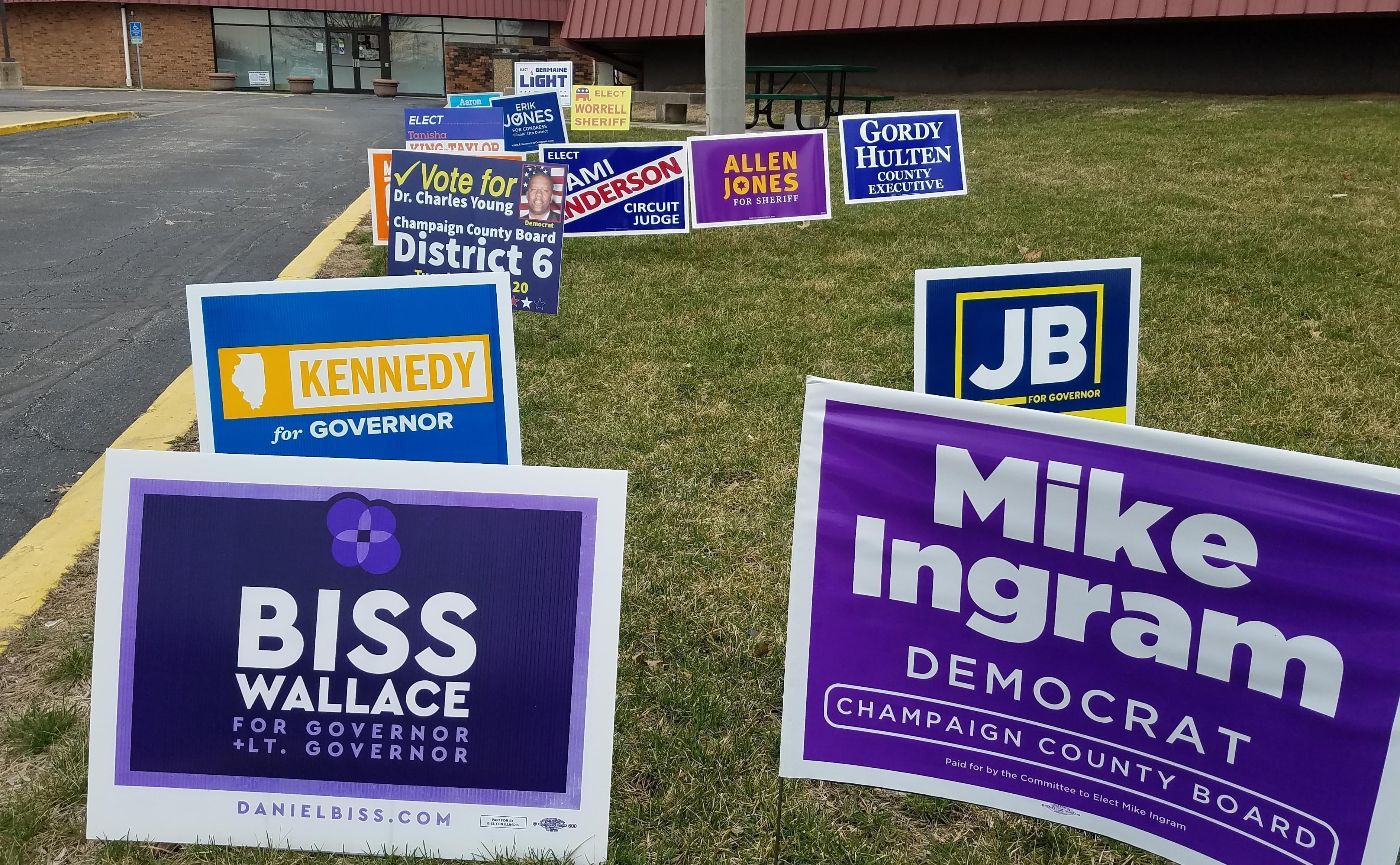 Candidates' signs outside the Champaign County Brookens Center in Urbana.