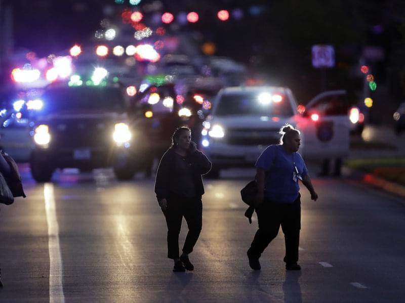 People evacuate as emergency vehicles stage near the site of another explosion on Tuesday in Austin, Texas.