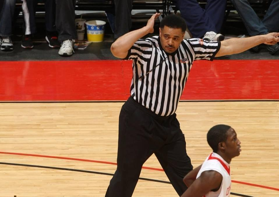 A referee at a high school basktball game
