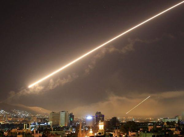 A surface-to-air missile lit up the sky in Damascus early Saturday morning after President Trump announced airstrikes would be launched to deter the Syrian government for allegedly using chemical weapons.