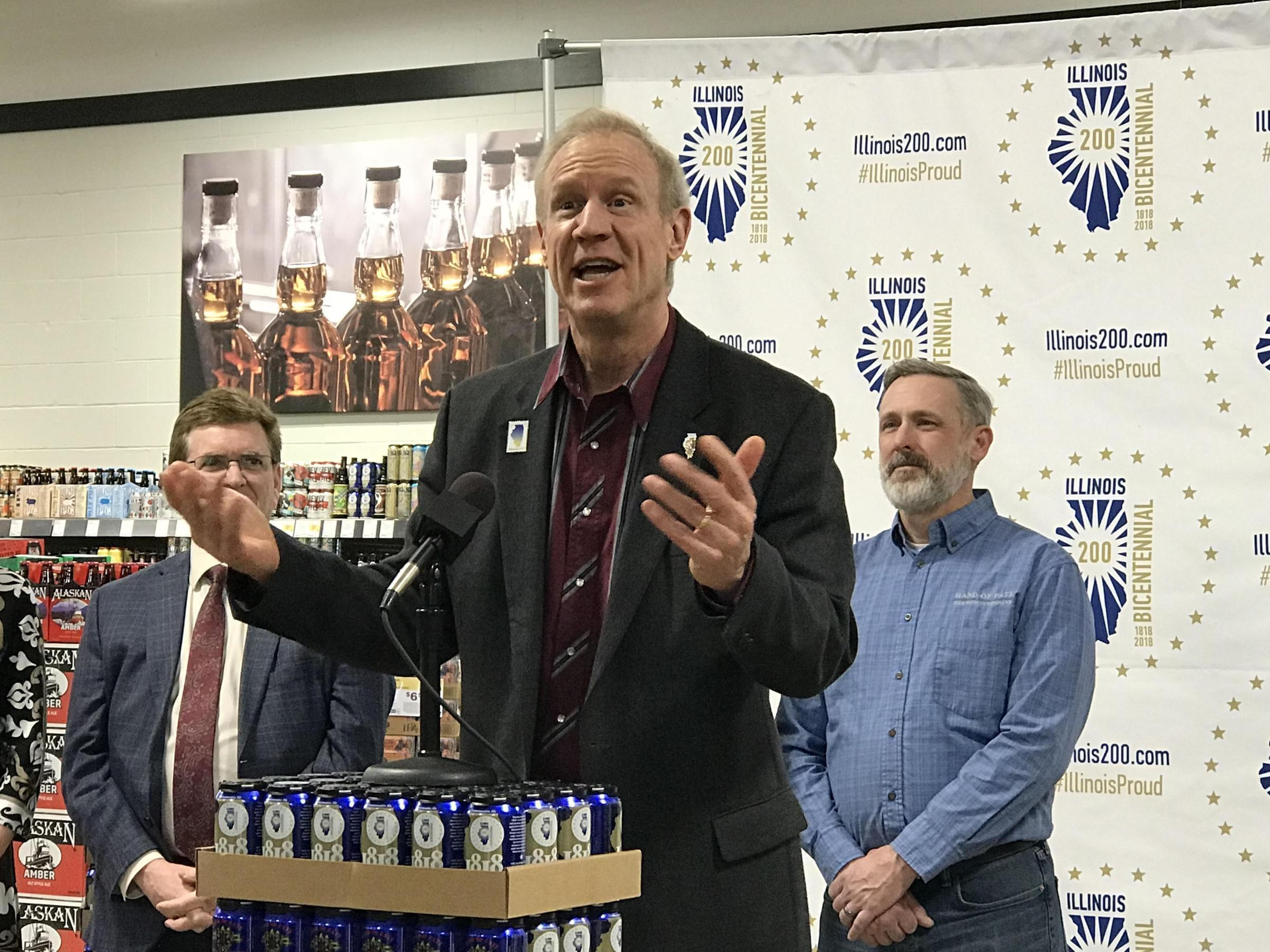 Gov. Bruce Rauner addresses the public at Binny's Beverage Depot in Springfield on March 14 at the unveiling of the official Bicentennial beer cans.