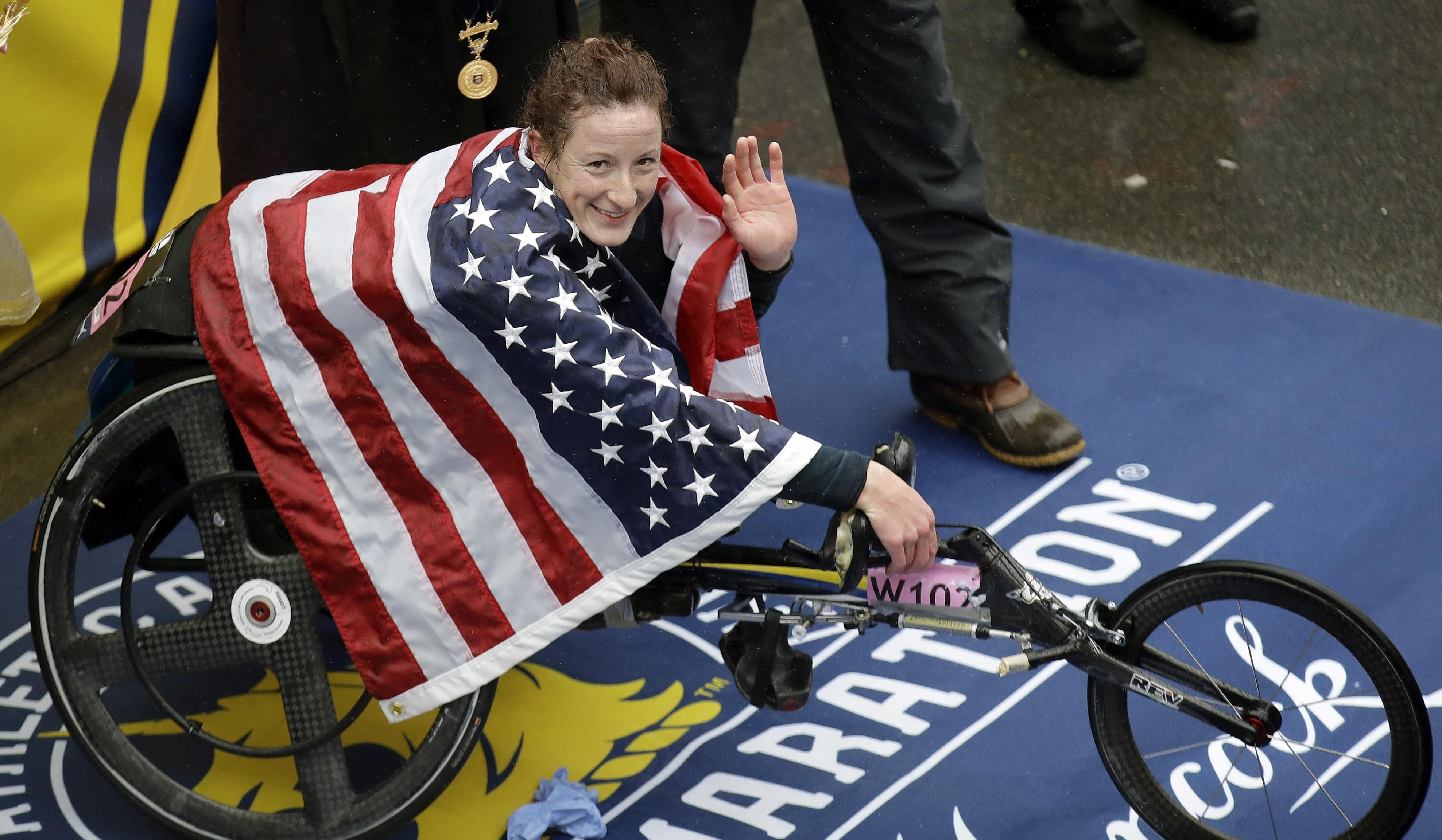 U of I graduate Tatyana McFadden, celebrates after winning the women's wheelchair division of the 122nd Boston Marathon.