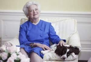 Barbara Bush, posing with her dog Millie in 1990.