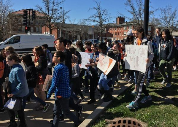 Uni High Students marching and displaying signs advocating for gun reform.