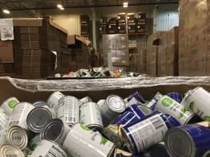 Bins of food wait to be sorted at Harvesters' warehouse in Kansas City, Missouri.