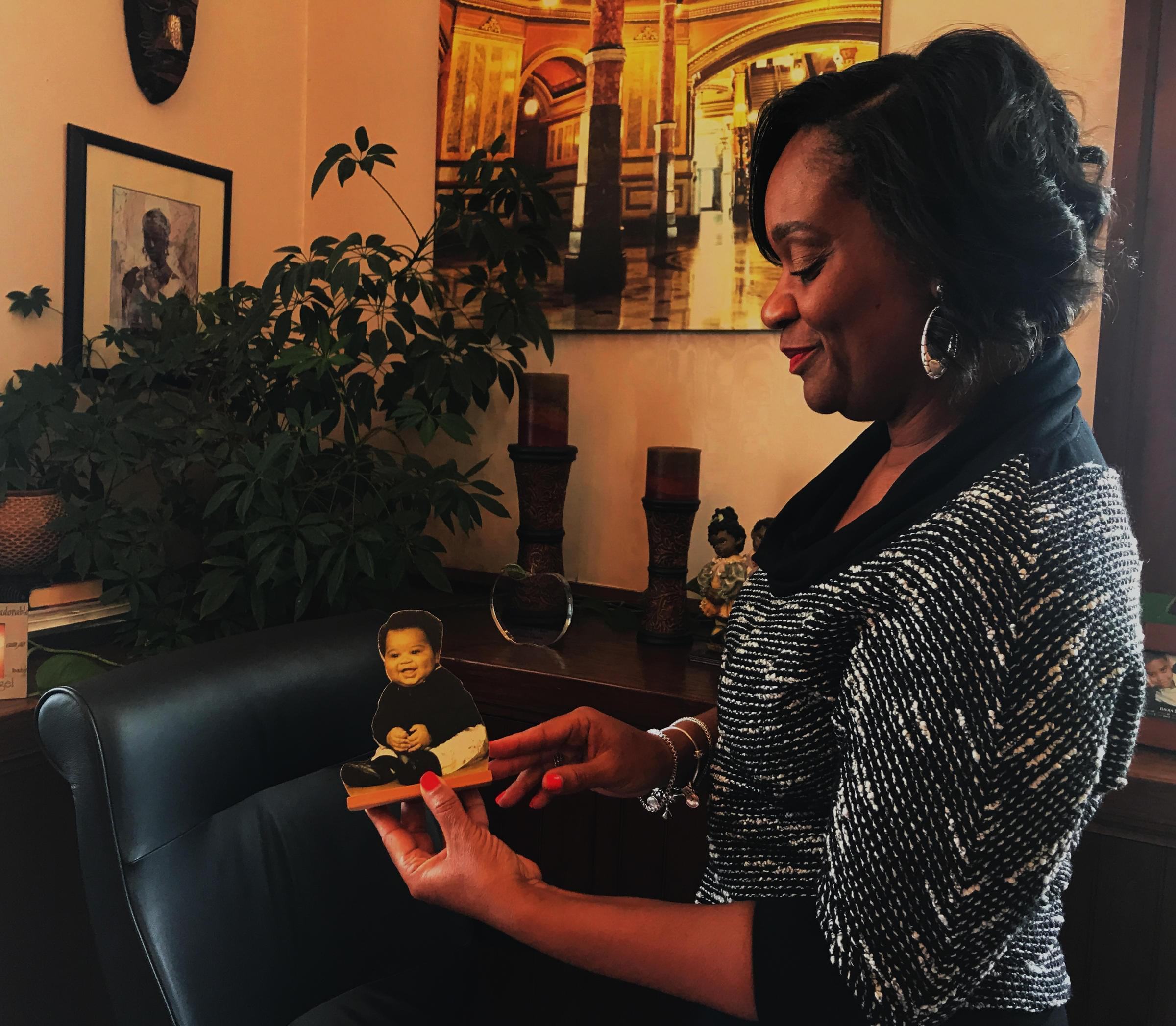 State Sen. Kimberly Lightford shows a picture of her son, Isaiah, who she had while serving in the Illinois Senate.