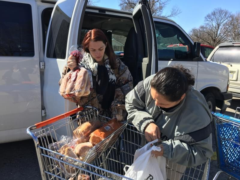 Amy Truckowski (left) and Sandra Viloria, both U.S. Army veterans, carpooled to the Leavenworth Mission Food Pantry in March to pick up a week's worth of groceries. The pantry is near the U.S. Army installation at Fort Leavenworth.